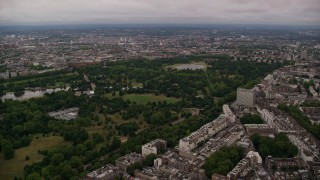 AX116_048 - 6K stock footage aerial video of approaching Kensington Gardens in London, England, twilight