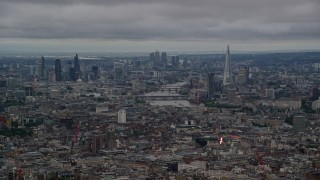 AX116_049 - 6K stock footage aerial video of a view of the River Thames and Central London skyscrapers, England, twilight