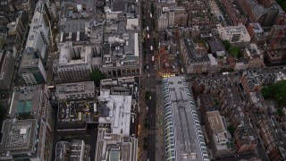 AX116_051 - 6K stock footage aerial video of a bird's eye view of double decker buses by Park House on Oxford Street, London, England, twilight
