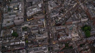 AX116_052 - 6K stock footage aerial video of a bird's eye view of traffic on Oxford Street, London, England, twilight