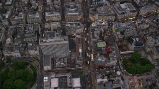 AX116_053 - 6K stock footage aerial video of a bird's eye view over Oxford Street to Oxford Circus, London, England, twilight