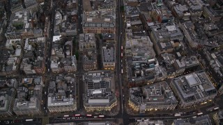 AX116_054 - 6K stock footage aerial video of a bird's eye view following Oxford Street from Oxford Circus, London, England, twilight