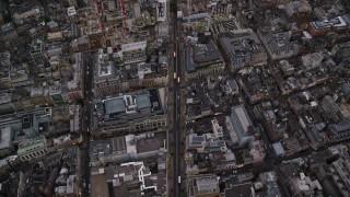 AX116_055 - 6K stock footage aerial video of a bird's eye view of following Oxford Street through London, England, twilight