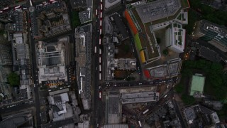 AX116_056 - 6K stock footage aerial video of a bird's eye view over Oxford Street, reveal Central St Giles, London, England, twilight