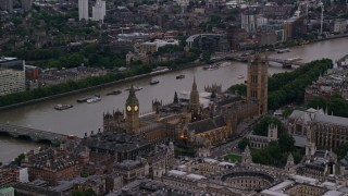 AX116_061 - 6K stock footage aerial video of Big Ben and British Parliament beside River Thames, London, England, twilight