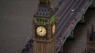 AX116_064 - 6K stock footage aerial video of an orbit of Big Ben by the River Thames, London, England, twilight