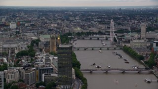 AX116_070 - 6K stock footage aerial video of Big Ben, London Eye and bridges spanning the River Thames, London, England, twilight