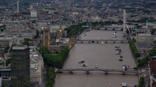 AX116_071 - 6K stock footage aerial video of Parliament, and bridges spanning the River Thames, London, England, twilight