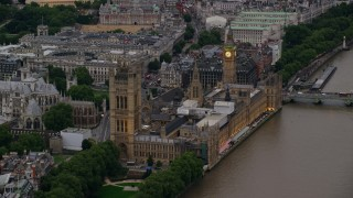 AX116_073 - 6K stock footage aerial video of approaching Big Ben and British Parliament from River Thames, London, England, twilight