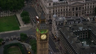 AX116_077 - 6K stock footage aerial video of orbiting famous Big Ben in London, England, twilight