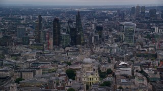 AX116_081 - 6K stock footage aerial video pan across skyscrapers and Central London cityscape, London, England, twilight