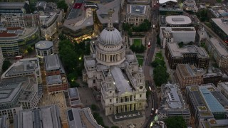 AX116_083 - 6K stock footage aerial video approach St Paul's Cathedral in London, England, twilight