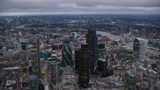 AX116_087 - 6K stock footage aerial video of an orbit of tall skyscrapers in Central London, England, twilight