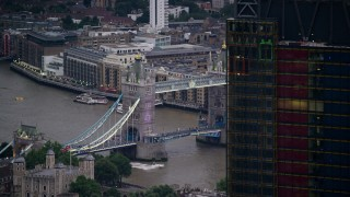 AX116_088 - 6K stock footage aerial video flyby 122 Leadenhall Street to reveal Tower Bridge and River Thames, London, England, twilight