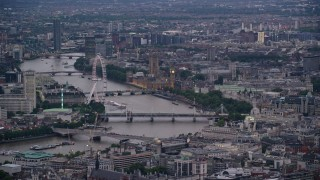AX116_094 - 6K stock footage aerial video of London Eye, bridges over River Thames, Big Ben and British Parliament, London, England, twilight