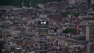 AX116_098 - 6K stock footage aerial video of an orbit of the top of BT Tower, London, England, twilight