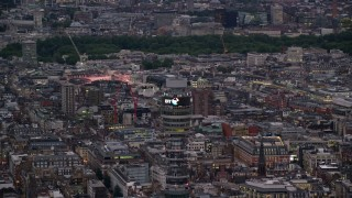 AX116_099 - 6K stock footage aerial video of circling the top of BT Tower, London, England, twilight