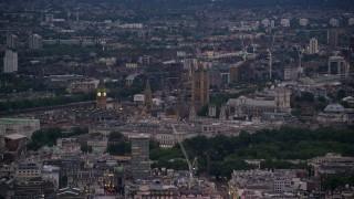 AX116_100 - 6K stock footage aerial video of flying by Big Ben, Parliament, and Westminster Abbey in London, England, night