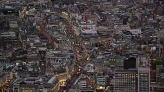 AX116_101 - 6K stock footage aerial video of zooming in on Regent Street, London, England, night
