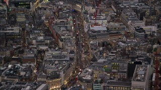 AX116_102 - 6K stock footage aerial video of flying by Regent Street in London, England, night
