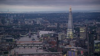 AX116_103 - 6K stock footage aerial video of Tower Bridge spanning River Thames near The Shard, London, England, night