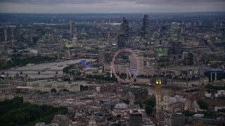 AX116_117 - 6K stock footage aerial video of London Eye, Big Ben and the British Parliament, London, England, night