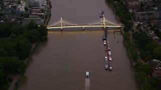 AX116_122 - 6K stock footage aerial video of flying toward Albert Bridge spanning River Thames, London, England, night