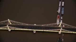 AX116_125 - 6K stock footage aerial video bird's eye view of Albert Bridge over River Thames, London, England, night