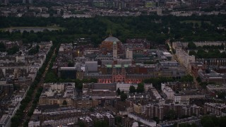 AX116_126 - 6K stock footage aerial video of Royal Albert Hall, Queen's Tower, and Natural History Museum, London, England, night