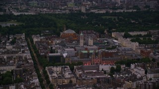AX116_127 - 6K stock footage aerial video flyby Royal Albert Hall, Queen's Tower, Natural History Museum in London, England, night