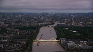 AX116_129 - 6K stock footage aerial video a view of London Cityscape and River Thames from Albert Bridge, England, night