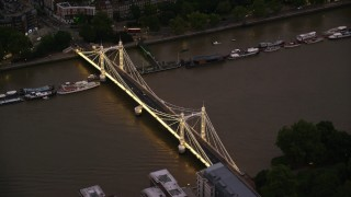 AX116_134 - 6K stock footage aerial video of cars crossing Albert Bridge spanning River Thames, London, England, night