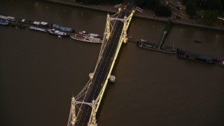 AX116_135 - 6K stock footage aerial video of orbiting Albert Bridge spanning River Thames in London, England, night
