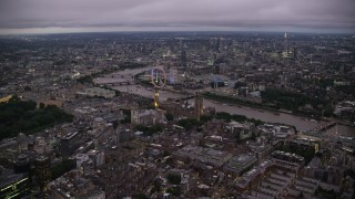 AX116_140 - 6K stock footage aerial video approach Big Ben, British Parliament, London Eye, and Westminster Abbey, London, England, night