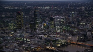 AX116_148 - 6K stock footage aerial video of passing by Central London Skyscrapers, London, England, night
