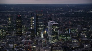 AX116_151 - 6K stock footage aerial video of tall skyscrapers in Central London, England, night