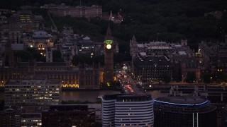 AX116_154 - 6K stock footage aerial video of flying by famous Big Ben and British Parliament, London, England, night