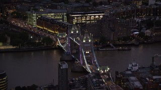 AX116_155 - 6K stock footage aerial video of orbiting Tower Bridge spanning River Thames, London, England, night