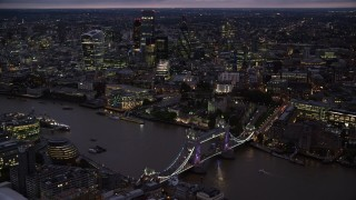 AX116_157 - 6K stock footage aerial video orbiting Tower Bridge and River Thames near Tower of London, England, night