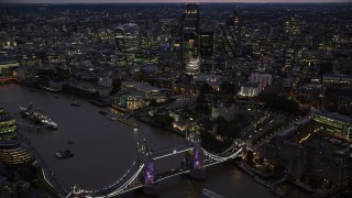 AX116_158 - 6K stock footage aerial video of Tower Bridge and River Thames near Tower of London and skyscrapers, England, night