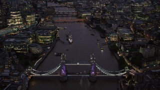 AX116_159 - 6K stock footage aerial video of orbiting Tower Bridge and River Thames in London, England, night