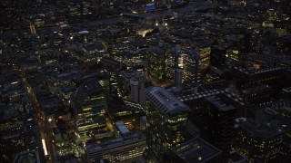 AX116_171 - 6K stock footage aerial video of flying by Central London office buildings, London, England, night