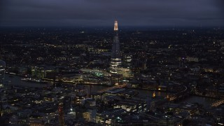 AX116_173 - 6K stock footage aerial video of a view of The Shard and River Thames, London, England, night