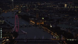 AX116_177 - 6K stock footage aerial video flyby London Eye, Big Ben and Parliament, River Thames bridges, London, England, night