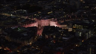 AX116_179 - 6K stock footage aerial video of orbiting the bright lights of Piccadilly Circus, London, England, night