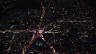 AX116_187 - 6K stock footage aerial video of an orbit of Piccadilly Circus and city buildings, London, England, night