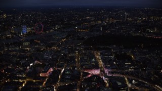 AX116_188 - 6K stock footage aerial video fly past Piccadilly Circus, with a view of London Eye and Big Ben, London, England, night