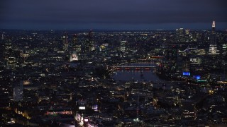 AX116_190 - 6K stock footage aerial video of flying by Central London cityscape around River Thames, London, England, night