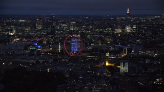 AX116_194 - 6K stock footage aerial video of London Eye, Big Ben by the River Thames, London, England, night