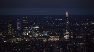 AX116_200 - 6K stock footage aerial video of a view of The Shard and skyscrapers in Central London, England, night
